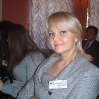 Julia Sutuginiene - certified TORFL examiner